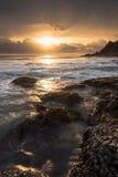Puesta del sol hermosa en la playa Imagen de archivo libre de regalías