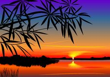 Puesta del sol hermosa sobre el lago Fotografía de archivo