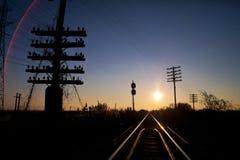 Puesta del sol sobre el ferrocarril imágenes de archivo libres de regalías