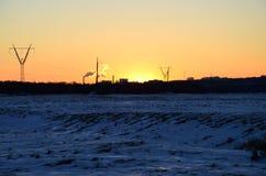 Puesta del sol industrial del invierno Imagen de archivo libre de regalías