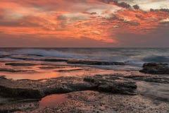 Puesta del sol inflamada Imagen de archivo libre de regalías