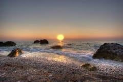 Puesta del sol jónica Imagenes de archivo
