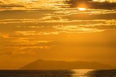 Puesta del sol jónica Foto de archivo libre de regalías