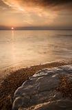 Puesta del sol jurásica de la costa Imagen de archivo libre de regalías