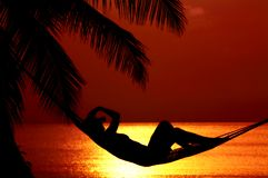 Puesta del sol lounging Imagen de archivo
