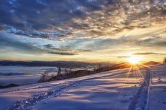 Puesta del sol majestuosa en el invierno Fotografía de archivo libre de regalías