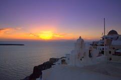 Puesta del sol maravillosa en Oia, Santorini Imágenes de archivo libres de regalías
