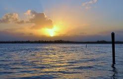 Puesta del sol nublada Imágenes de archivo libres de regalías