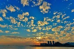 Puesta del sol nublada Imagen de archivo