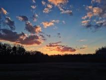 Puesta del sol nublada Foto de archivo libre de regalías