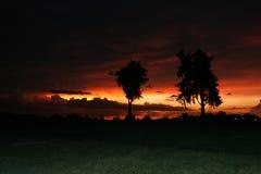 Puesta del sol oscura Fotografía de archivo