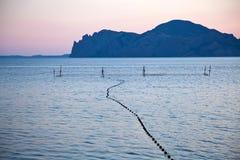 Puesta del sol púrpura en el Mar Negro Imagenes de archivo
