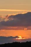 Puesta del sol púrpura y anaranjada Fotos de archivo libres de regalías