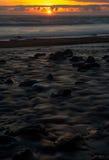 Puesta del sol perdida de la costa Fotografía de archivo libre de regalías