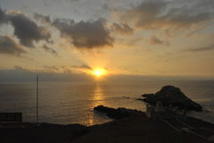 Puesta del sol Pisagua Foto de archivo libre de regalías