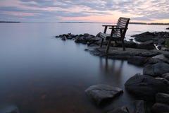 Puesta del sol por el lago Fotos de archivo libres de regalías