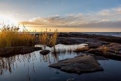 Puesta del sol por el mar Fotografía de archivo libre de regalías