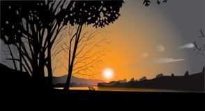 Puesta del sol por el río Foto de archivo