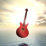Puesta del sol que flota la guitarra eléctrica Fotos de archivo libres de regalías