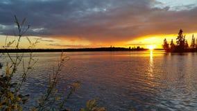 Puesta del sol reflexiva Fotos de archivo libres de regalías