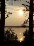 Puesta del sol rocosa del lago Imagen de archivo