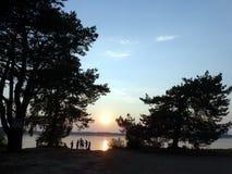 Puesta del sol rocosa del lago Imagenes de archivo