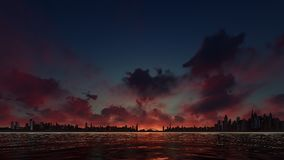 Puesta del sol roja en una ciudad del rascacielos Imagen de archivo