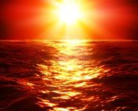 Puesta del sol roja sobre el mar Fotos de archivo libres de regalías