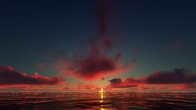 Puesta del sol rojo oscuro en el mar Fotos de archivo libres de regalías