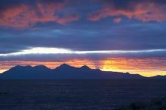Puesta del sol, ron, Hebrides interno, Escocia Fotografía de archivo libre de regalías