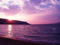 Puesta del sol rosada y violeta Imagen de archivo