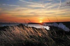 Puesta del sol sobre Birling Gap Imagen de archivo