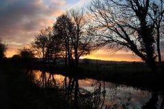 Puesta del sol sobre el canal occidental magnífico Fotografía de archivo libre de regalías