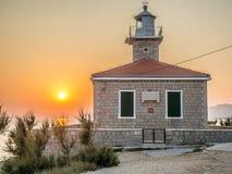 Puesta del sol sobre el faro Fotos de archivo libres de regalías