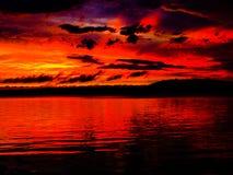Puesta del sol sobre el lago rice Foto de archivo libre de regalías