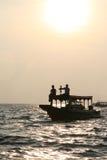 Puesta del sol sobre el lago sap de Tonle en Camboya Foto de archivo libre de regalías