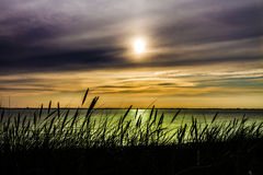 Puesta del sol sobre el mar IV Foto de archivo libre de regalías