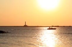 Puesta del sol sobre el mar jónico, Gallipoli, Italia Foto de archivo