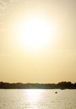 Puesta del sol sobre el mar y la ciudad Imágenes de archivo libres de regalías