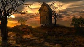 Puesta del sol sobre el molino de viento viejo Foto de archivo libre de regalías
