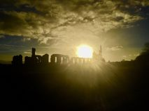Puesta del sol sobre la abadía de Byland Imagenes de archivo