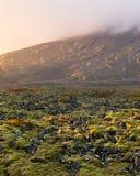 Puesta del sol sobre la lava Fotos de archivo libres de regalías