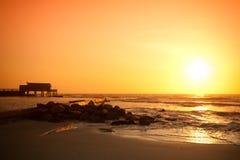 Puesta del sol sobre la playa de Langstrand Imágenes de archivo libres de regalías