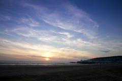 Puesta del sol sobre la playa estupenda de la yegua de Weston Foto de archivo libre de regalías