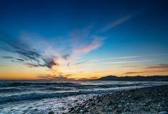 Puesta del sol sobre la playa, Marbella, España Imagen de archivo libre de regalías