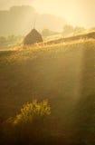Puesta del sol sobre las colinas Imagenes de archivo
