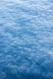 Puesta del sol sobre las nubes Foto de archivo libre de regalías
