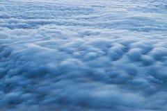Puesta del sol sobre las nubes Fotografía de archivo libre de regalías