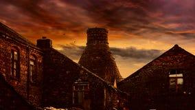 Puesta del sol sobre los hornos de la botella Imagen de archivo