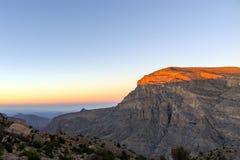 Puesta del sol sobre los impostores de Jebel - Omán fotos de archivo libres de regalías